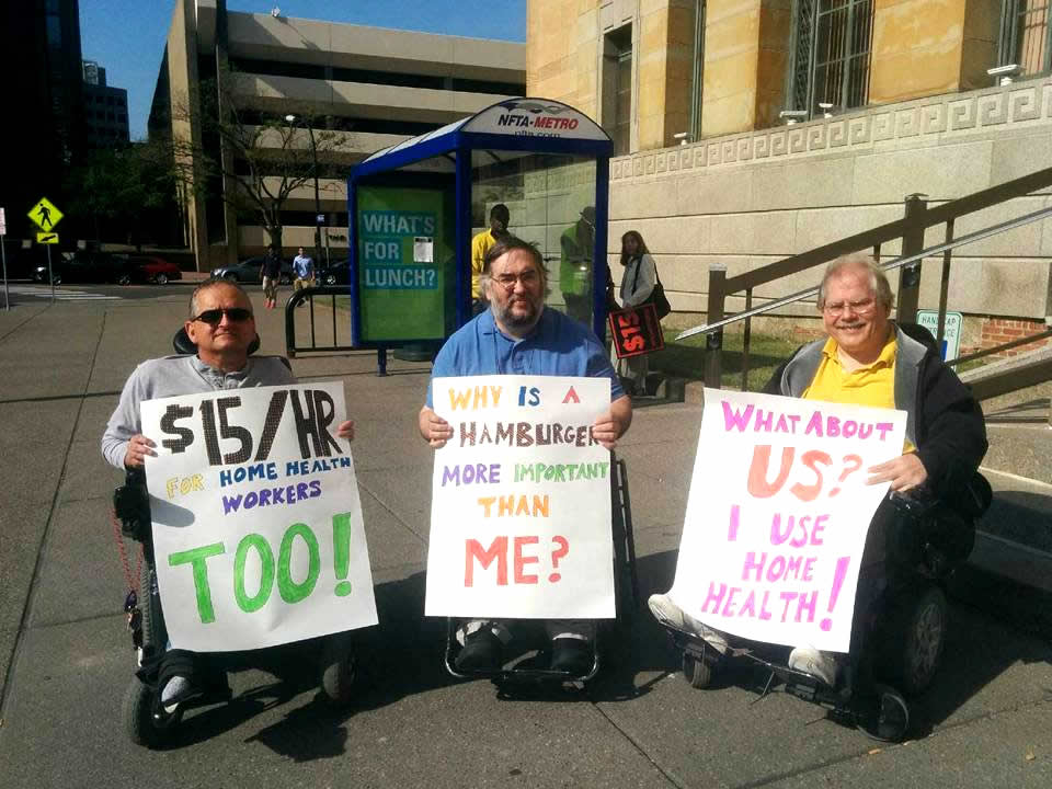 Three Disability Acvocates with signs for fair wages